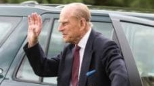 Doting grandpa Prince Philip back in action in his first outing since hospital stay