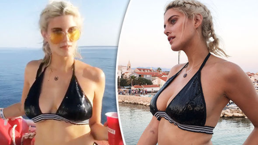 Ashley James's large assets threaten to spill out of plunging bikini in sizzling snaps