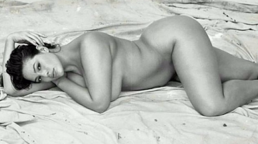 Ashley Graham sparks frenzy as she strips totally naked in moody boob-baring snap