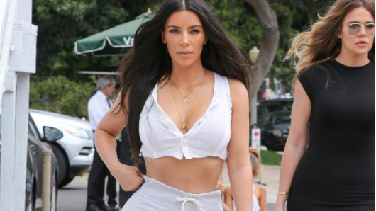 Kim Kardashian flashes her tummy