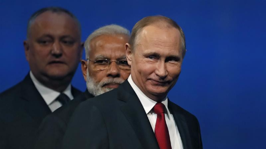 Putin: 'Don't worry, be happy' as Trump ditches climate