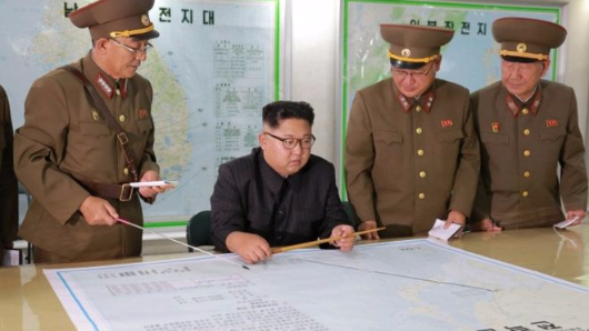 N Korea leader holds off on Guam threat