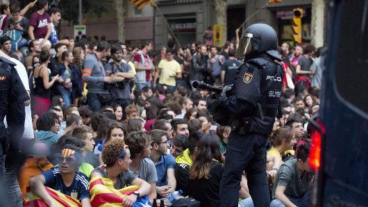 Tens of thousands hit Barcelona streets to protest separatist crackdown