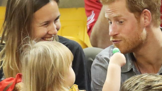 Cheeky toddler meets Prince Harry