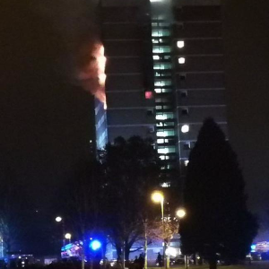 High-rise tower engulfed in flames