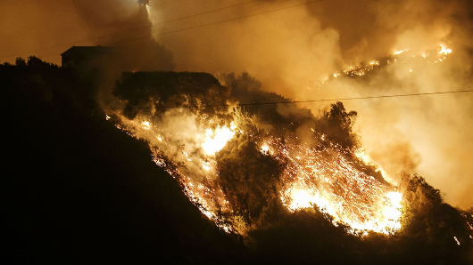Record California fire almost contained